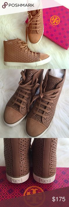 Floral High Tops Floral perforated high top sneakers •leather upper / leather lining / suede tip / rubber sole• color description on box reads: natural blush but more like a tan. SOLD OUT in stores *NO TRADES* Tory Burch Shoes Sneakers