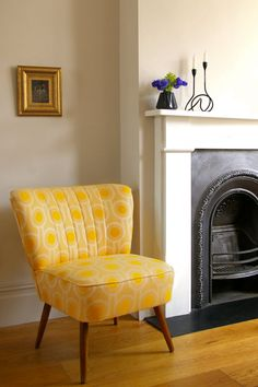 Elegant and comfortable mid-century cocktail chairs featuring iconic splayed legs. The chair in yellow Benedict Dawn Fabric has stitched back detail.  The
