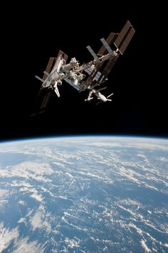 ISS027-E-036706 (23 May 2011) --- This image of the International Space Station and the docked space shuttle Endeavour, flying at an altitude of approximately 220 miles, was taken by Expedition 27 crew member Paolo Nespoli from the Soyuz TMA-20 following its undocking on May 23, 2011 (USA time).