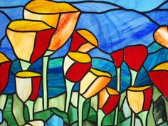 Mountain Scenic California Poppies 41 x 26.75- Stained Glass Window Panel  This is a new horizontal Mountain Scenic California Poppy panel. It is an expansion of the vertical panel also shown, and will have a similar look. The border is made from 1.5 beveled and clear textured glass. The panel has a heavy duty 1/2 inch zinc came frame surrounding the piece with hanging rings securely attached at the top corners. Chain for hanging will be included. The panel measures 41 x 26.75.  This panel…