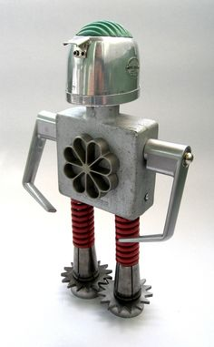 https://flic.kr/p/6QunjV | Crouse - Found Object Robot Assemblage Sculpture | Robot sculpture assembled from found objects by Brian Marshall - Wilmington, DE. Items included in my sculptures vary from vintage household kitchen items to recycled industrial scrap. Some of my favorite items to use are old oil cans, aluminum measuring spoons, electrical meters, retro blenders, anodized cups, and pencil sharpeners.