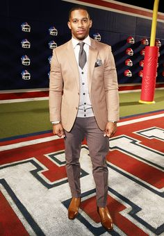 Victor Cruz in a neutral colored suit
