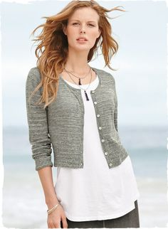 Knit in slubby, striated yarns of pima (59%) and nylon (41%), this cropped, textured cardigan is the perfect coverup.