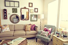 Light filled, eclectic wall display, sculptural lamp, comfy cushions in fun prints!