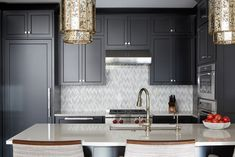 Loving the black shaker cabinets paired with the white mosaic backsplash tile. Click the image to view more photos from this project! Photographed by reidrolls. Mosaic Backsplash, Marble Mosaic, Shaker Cabinets, Black Cabinets, Black Kitchens, City Living, Kitchen Design, Neutral, New Homes