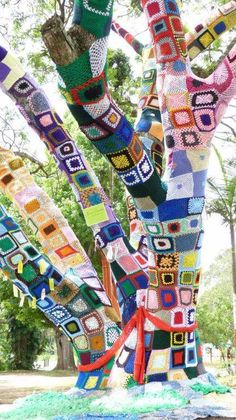 Yarnbomb tree at the hillcrest aids centre in South Africa, made up of granny squares.