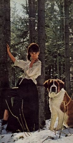 "Audrey Hepburn, in Givenchy and René Mancini for Givenchy shoes, photographed with a St. Bernard by Howell Conant at a country estate near Lucerne (Switzerland), for a fashion editorial for the American LIFE magazine, called ""Audrey Stars in Givenchy Styles"" (edition of May 11, 1962, unpublished photo), in February 1962."