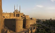 THE SALADIN CITADEL 0F CAIRO  is a medieval Islamic fortification in Cairo, Egypt. The location, on Mokattam hill near the center of Cairo, was once famous for its fresh breeze and grand views of the city. It is now a preserved historic site, with mosques and museums.   (en.wikipedia.org)