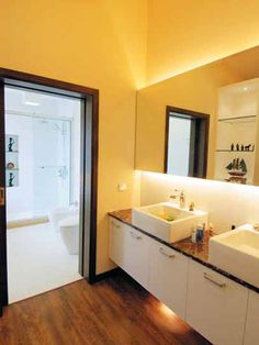 Bathroom Lighting- Backlit mirrors above vanity to provide accent lighting and add a special tough!