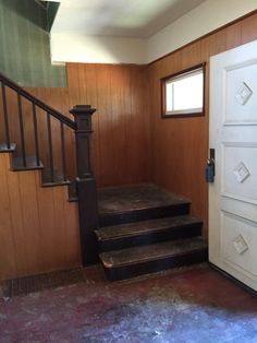 """The entry and """"grand"""" staircase."""