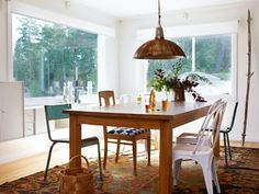 Beautiful woodenI want this much light, dinning table leading to fully openable french doors and balcany