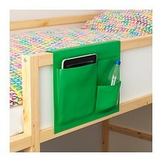IKEA - STICKAT, Bed pocket, , Clever storage solution that you can hang on our children's beds.Three pockets in different sizes make it simple to organise both bigger and smaller items.You can easily wipe off lighter stains with a damp cloth, or hand-wash at 40°C.