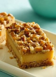 Praline Crumb Caramel Cheesecake Bars | Enjoy cheesecake in the form of an easy bar with layers of caramel, rich toffee and crunchy nuts..