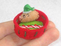 Guinea pig Santa in Christmas basket - felt plush stuffed toy. $11.00, via Etsy.  (Momo?)
