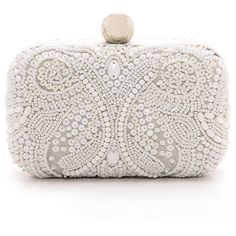 Paisley patterns rendered in delicate beadwork accent this Santi box clutch. A kiss lock clasp opens the hinged frame. Satin lining. Optional, cross body strap…