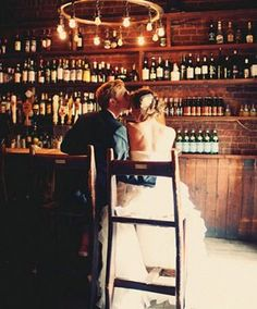If you are lucky enough to have a neighborhood tavern that's wedding-worthy, don't forget to use the bar as a pretty backdrop for your portraits  @myweddingdotcom