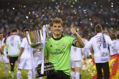 Iker Casillas of Real Madrid holds the Copa del Rey trophty after Real beat Barcelona 2-1 in the final at Estadio Mestalla on April 16, 2014 in Valencia, Spain.