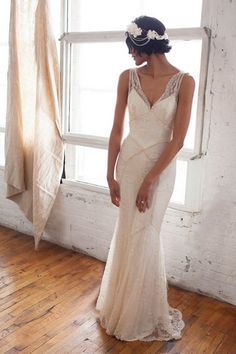 A vintage styled beaded beach wedding dress. See more here: 25 Beach Wedding Gowns {Trendy Tuesday} | Confetti Daydreams ♥ ♥ ♥ LIKE US ON FB: www.facebook.com/confettidaydreams ♥ ♥ ♥