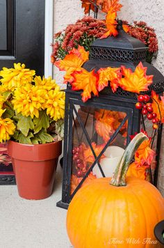 Quick Easy Front Porch Fall Decorating Ideas ~ Outdoor fall mums, pumpking, fall decorated balck lantern creaete a gorgeous fall vignette / timewiththea.com