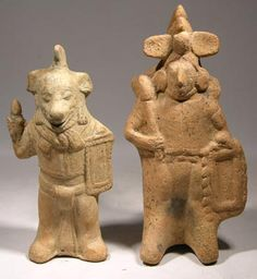 Two Maya Jaina Island Whistle Figures — Campeche, Mexico  500 AD - 700 AD  Two Maya (Mayan) Jaina Island molded whistle figures. They depict warriors holding shields and weapons. Both have functional whistles (ocarinas) incorporated into the base. The whistles work well and have nice clear tones.