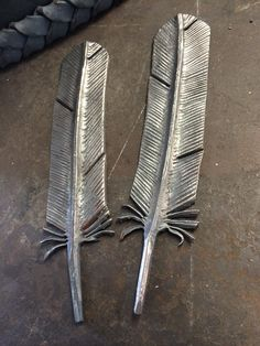 Hand forged feathers for a chandelier.