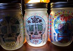 Decorative Dia De Los Muertos themed mason jar lanterns with recharchable solar LED lids on Etsy, $15.00