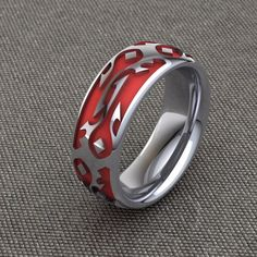 Prove your allegiance to the Horde with this custom enameled band. Available in 14k gold, sterling, palladium and platinum.Comes standard with