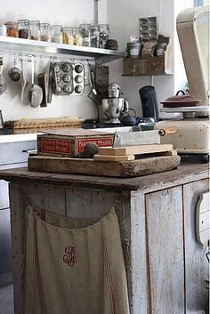 Hang a pretty vintage grain sack on the side of a cabinet. Now off to find me a pretty vintage bag...