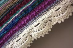 beautiful scrappy shawl - love the crochet border-body is knitted with crochet edging, no pattern. Inspiration*