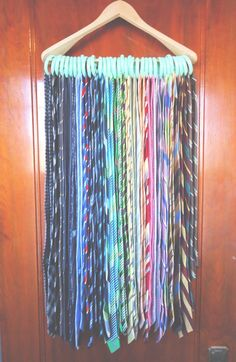 How to Organize Ties! Works for scarves and baseball hats too. Wooden hanger plus round shower curtain hooks.
