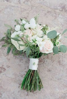 This elegant-yet-natural bouquet features trailing eucalyptus amongst the roses, ranunculus, and hydrangeas. #texasblooms #weddingbouquet #florist #weddingflowers