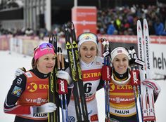 First placed Sweden's Stina Nilsson, centre, second placed Norway's Maiken Caspersen Falla, left, and third placed Norway's Heidi Weng celebrate after the women's 1.4 km sprint qualification event at the FIS Cross Country World Cup in Falun, Sweden, Saturday Jan. 28, 2017.
