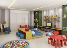 Form study room with modern decor of this child tables and chairs blue and there is a pool of plastic balls and a little red chair desk two