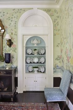Absurdly beautiful original built-in with fluted pilaster, half shell, and keystone detailing, as well as a lovely light blue painted interior. Gorgeous light green hand painted Chinoiserie paper doesn't hurt either.
