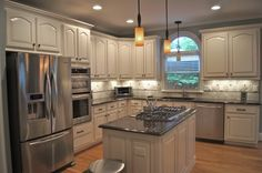 Painted oak cabinets.