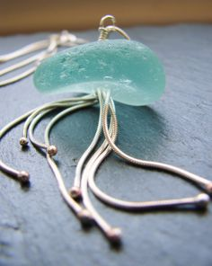 Sea Creature bright aqua sea glass and sterling silver necklace.