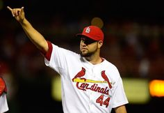 Closer Edward Mujica celebrates after defeating the Los Angeles Dodgers 5-1...8-06-13