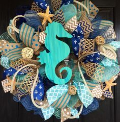 Summer deco mesh wreath,burlap nautical wreath, seahorse wreath, seahorse mesh wreath, beach wreath,front door beach wreath, nautical wreath by ShellysChicDesigns on Etsy https://www.etsy.com/listing/238534224/summer-deco-mesh-wreathburlap-nautical