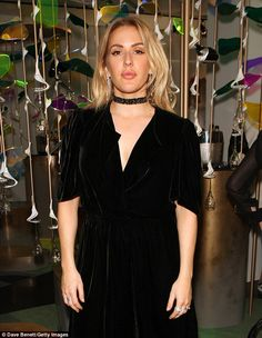 She wore black velvet: The 29-year-old singer turned heads in a plunging black velvet dress