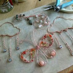 On the bench, a variety of wire work designs. All constructed and ready to be oxidised.