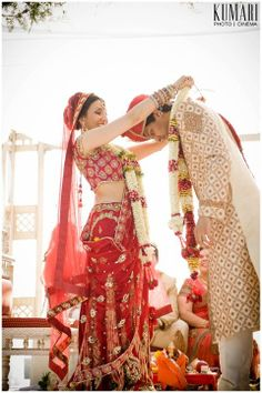 Exchanging garlands at the auspicious time- an important ceremony in Hindu weddings