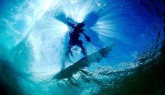 Underwater surf photography. Clear water with the sun shining through.