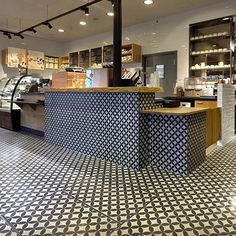 In the front of this store classic cement tiles with a graphic design are inspired by the tiles of the traditional buildings in the area. #WhereInTheWorld by starbucks