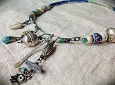 Bohemian gypsy amulet necklace with kyanite, hamsa, and shell