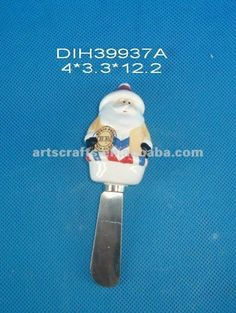 Ceramic Santa Claus Spreader (0nly one) - on Alibaba.com. Santa is NOT in traditional red suit. He wear a blue and white chevron patterned top. Does have full white beard/mustache and stocking cap, black mittens. Santa is only waist up.