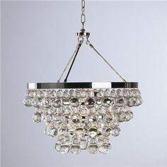 "above tub - Deco Glam Chandelier  True to Art Deco style, this fabulous crystal chandelier shines with brilliant metals and drips with loads of fabulous glass droplets. This statement piece is updated and ready to add glamour to any room in the house! Specify Bronze or Polished Nickel hardware. 4x60 watts (medium base bulb). (21""Hx21""W). Comes with 3' Chain. Glass Drops. Canopy can be mounted directly to ceiling to be hung as a semi-flush ceiling light. Crystal assembly required. $949.00"