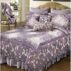 This Temme Quilt quilted bedding collection is based on a traditional Irish chain quilt pattern. Small squares of fabric are carefully arranged so their colors blend subtly into one another. Botanical motifs in soft lavender, ivory, green, periwinkle, wood rose and plum drift throughout the ensemble. Ornamental feather quilting patterns give the design an old-fashioned charm. Ruffle Bedding, Quilt Bedding, Quilt Sets Queen, Single Quilt, King Size Quilt, Quilt Sizes, Comforter Sets, Purple Bedding Sets, Bedding Collections