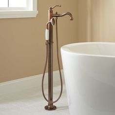 Buy the Signature Hardware 401245 Oil Rubbed Bronze Direct. Shop for the Signature Hardware 401245 Oil Rubbed Bronze Leta Floor Mounted Tub Filler- Includes Telephone Style Hand Shower and save. Clawfoot Tub Faucet, Vessel Faucets, Bathroom Faucets, Master Bathroom, Big Bathtub, Bronze Bathroom, Master Shower, Bathroom Showers, Hall Bathroom