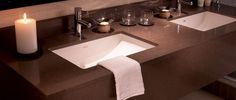 Caesarstone Lagos Blue 4350- commercial bathroom vanity. Visit globalgranite.com for more countertop options.