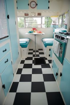 Turquoise, black and white vintage camper.